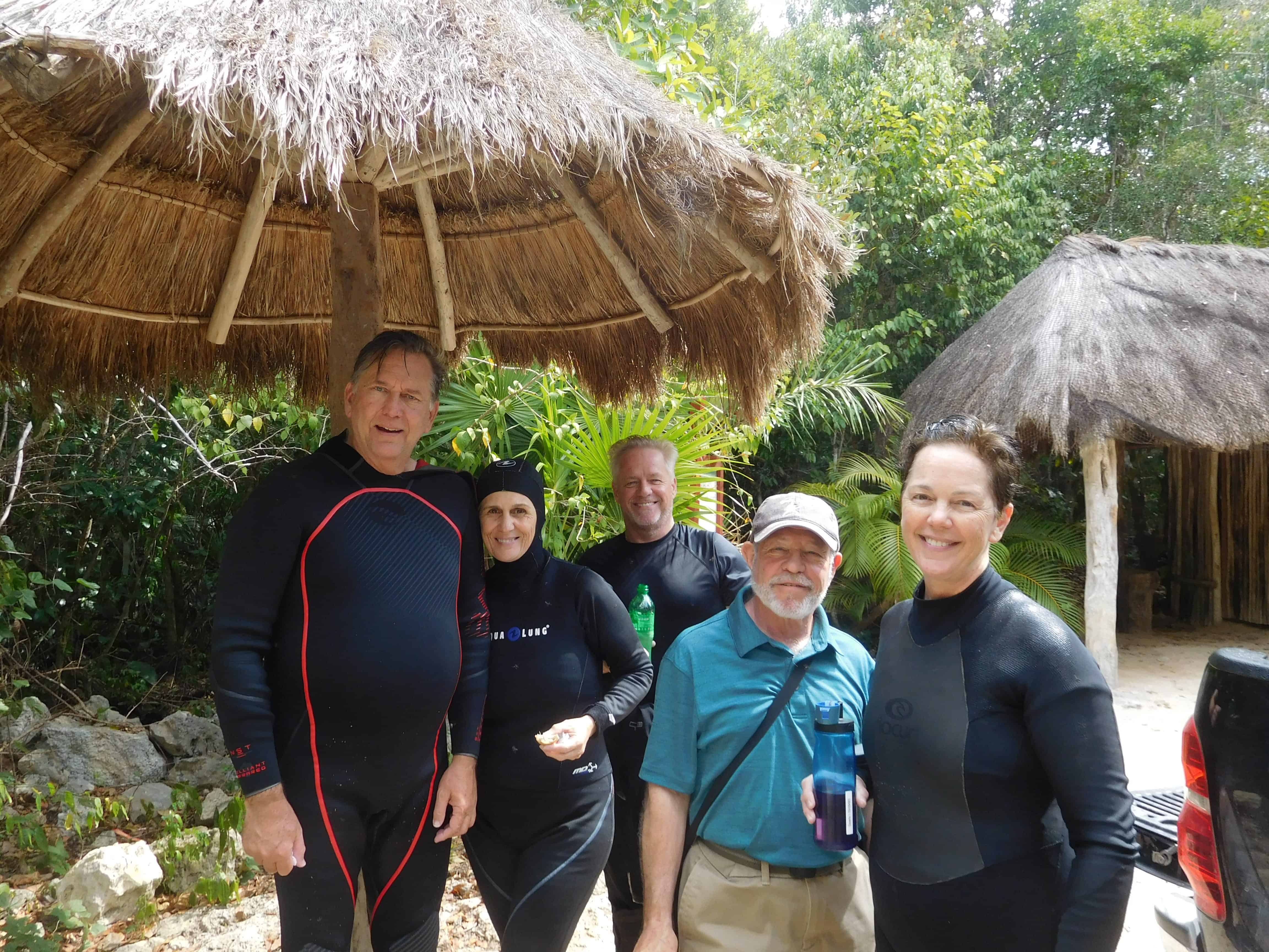 happy divers diving cenotes in playa del carmen