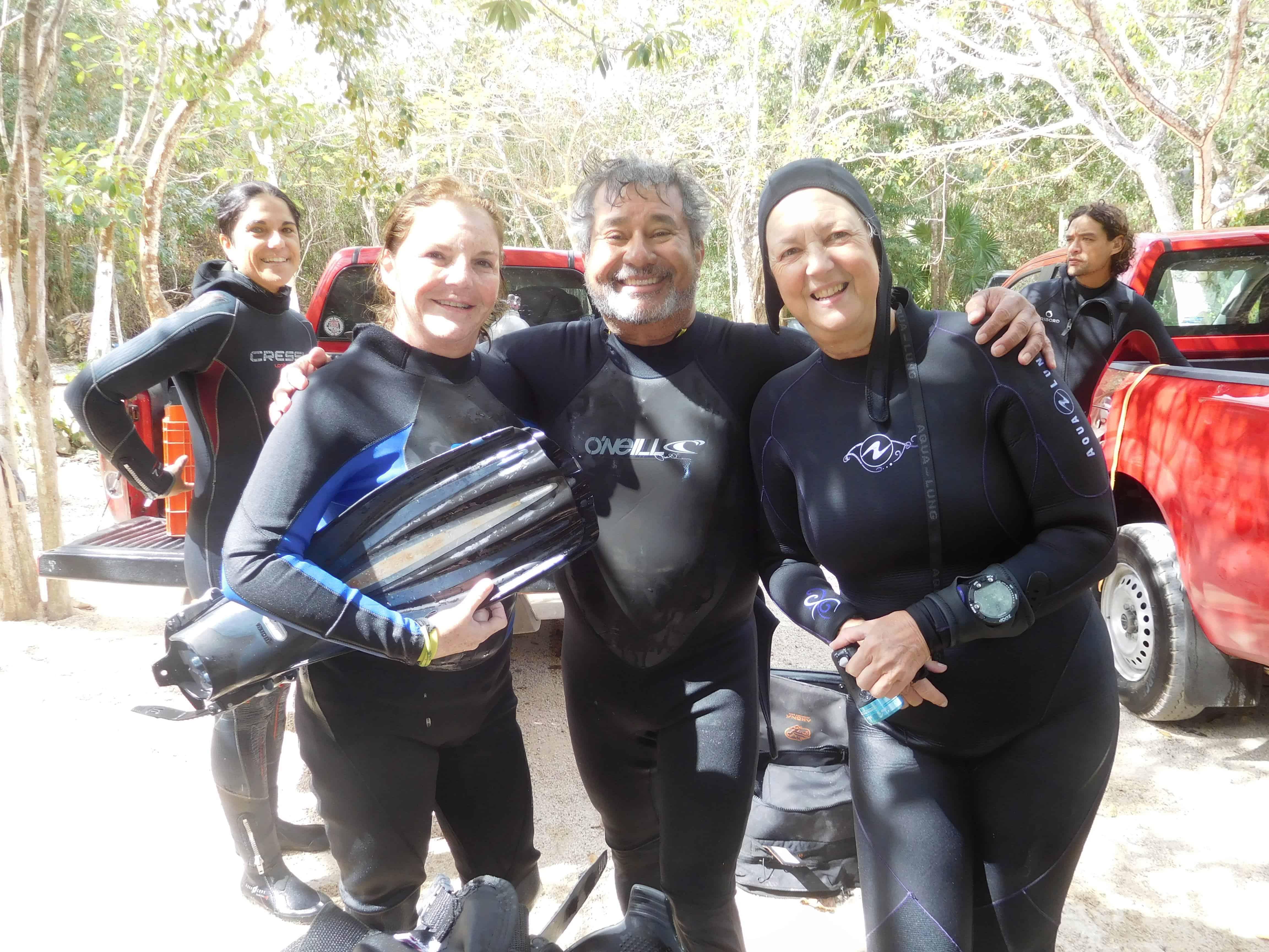 happy divers diving cenotes in playa del carmen